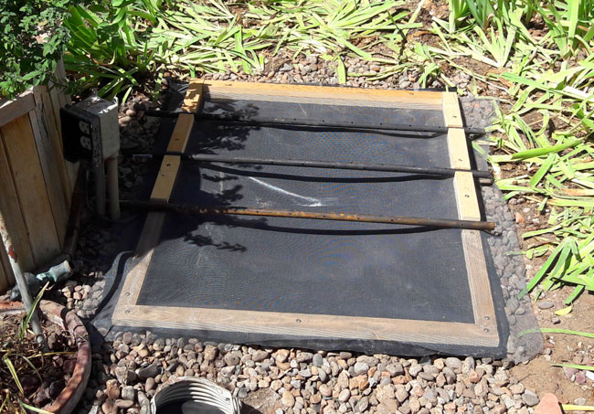 Recirculating Backyard Fountain: Add the Netting and Cross Stakes